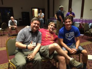 Fr. Jason Nesbit, left, enjoys a moment with Fr. Corey Brost, center, and one of the delegates at the Viatorian Youth Congress