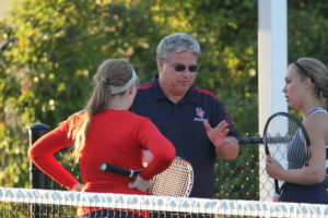 Br. Tripamer coaches girls in tennis at Saint Viator High School