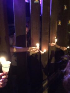 A solemn candlelight vigil drew emotions on both sides of the wall