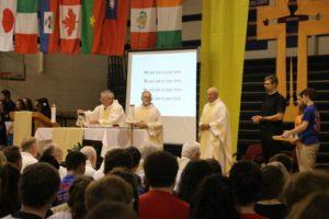 Fr. Dan Hall, right, concelebrating Mass on St. Viator day at Saint Viator High School, with Fr. Thomas von Behren, left and Fr. Dan Lydon, center