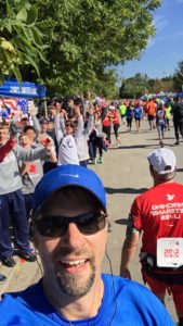 Br. John takes a selfie at a water station manned by members of the SVHS cross country team