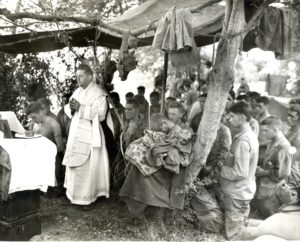 Fr. Charles Riedel leads Marines at Mass in Saipan during World War II