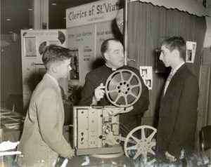 """Fr. Francis T. Williams promotes """"The Search"""" at a vocations fair in 1956"""