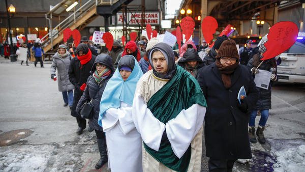 Fr. Moses Mesch, CSV, right, accompanies Mary and Joseph during the recent Posada in Chicago. (Photo by Jose M. Osorio, Chicago Tribune)