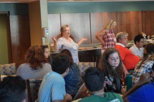 Associate Karen Cutler tries to get delegates' attention during the 2016 Viatorian Youth Congress