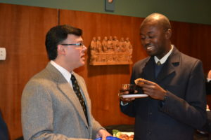 Br. Carlos Flórez, CSV, and Fr. Dudley Pierre, CSV, of Haiti, during a dinner after the Extraordinary General Council meeting in 2013