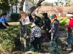 Members of the Women's Guild work together to decorate their tree