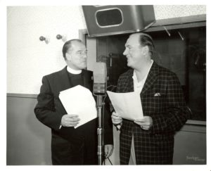 """Fr. Francis T. Williams goes over the script of """"The Search"""" with its narrator, actor Pat O'Brien in 1956"""