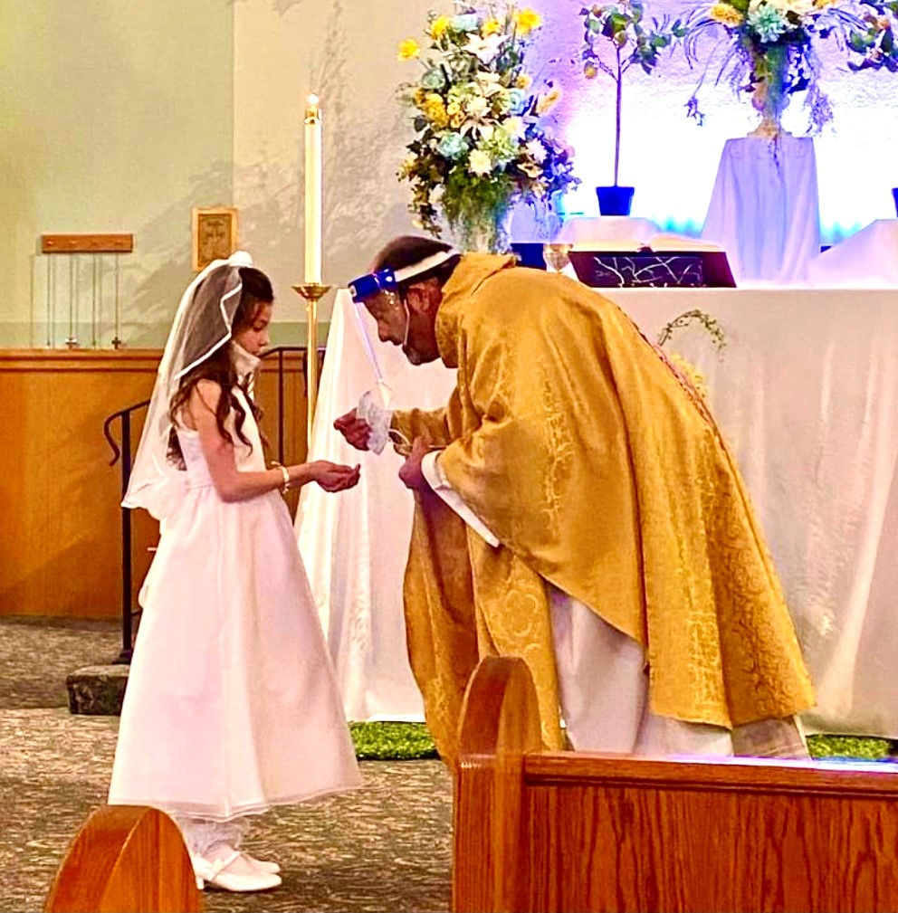 Belanger with first communicant